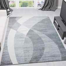 Tapis design moderne gris blanc forme courbée rayures à poils ras