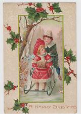 A Happy Christmas Boy Pushing Girl Sled Holly Postcard