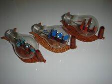 hand made wooden miniature ship in a light bulb