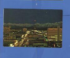 ANCHORAGE ALASKA 1976 POSTCARD AERIAL NIGHT VIEW  CHUGACH MOUNTAINS
