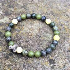 Celtic triple spiral bead. Irish Connemara marble unisex bracelet Newgrange