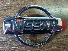 NEW OEM 1999-2001 NISSAN XTERRA FRONT GRILLE EMBLEM -FACTORY NISSAN PART