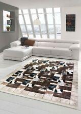 Patchwork de tapis en peau de vache brun crème noir