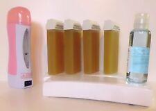 kit épilation 4 cire roll on +huile+chauffe cartouche+ 100 bandes d'epilation