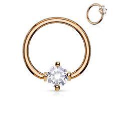 Piercing anneau captif plaqué or rose pierre ronde blanche