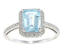 10k White Gold Emerald-Cut Blue Topaz and Diamond Ring (1/5 TDW)
