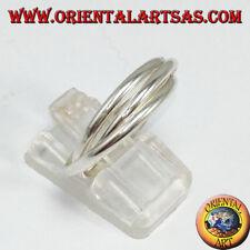 Anello in argento a tre fedine  incrociate da due millimetri