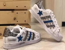adisas superstar con borchie argento e glitter azzurro a stella