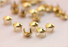 300pz  Borchie a cono con alette 6mm color oro chiar*300pz light gold CONE STUDS