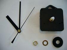 CLOCK MOVEMENT QUARTZ MEDIUM SPINDLE. 80mm BLACK HANDS