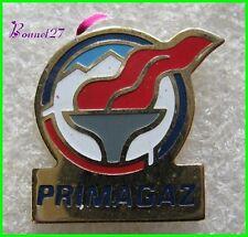 Pin's PRIMAGAZ Avec une Flamme Rouge #G1