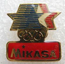 Pin's Marque MIKASA avec Etoile bleu blenc rouge JO #253