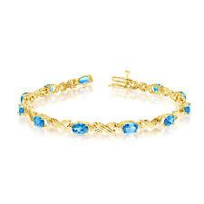 10K Yellow Gold Oval Blue Topaz and Diamond Bracelet