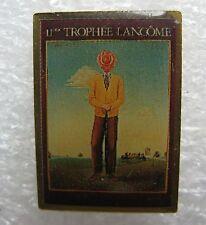 Pin's 11 Trophee Lancôme tableau Homme Ailés #1884