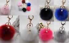 Porte cle bijoux de sac pompom fourrure avec sa perle