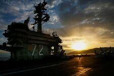 Sun sets over the aircraft carrier USS Abraham Lincoln CVN-72 Photo Print