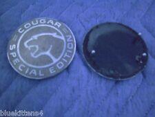 MERCURY COUGAR  SPECIAL EDITION GOLD SIDE EMBLEM LEFT