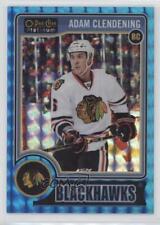 2014 O-Pee-Chee Platinum Blue Cubes #167 Adam Clendening Chicago Blackhawks Card