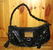 Handbag or shoulder bag with metal designer logo badge