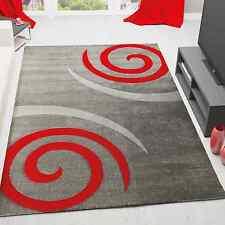 Alfombra moderna con contorno cortado a mano espirales en rojo y fondo gris